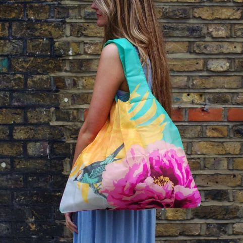 The Botanical Eco Bag by Loqi has a botanical print and a bird in lovely vibrant colours.