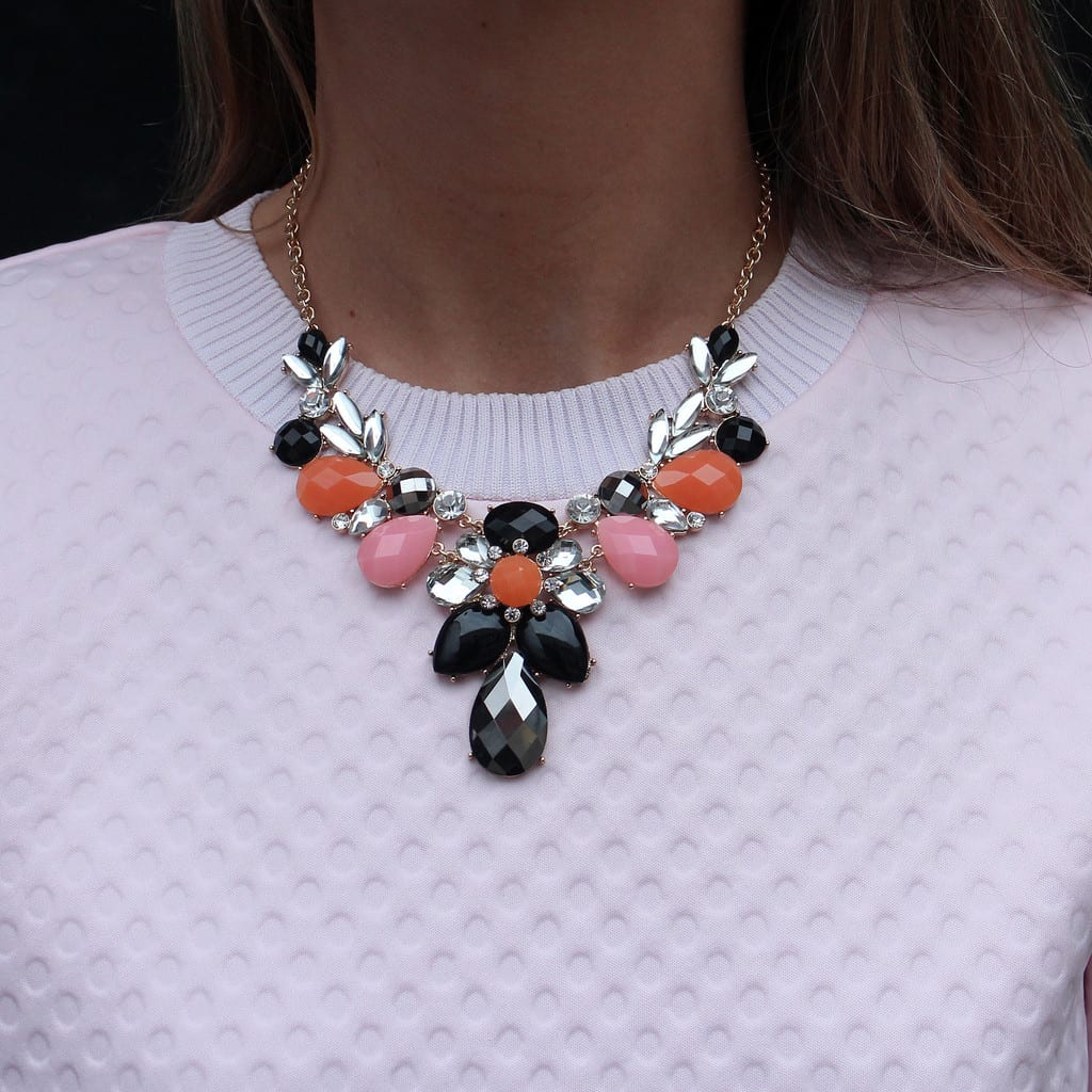 This is a gorgeous statement Necklace With Black, Crystal, Pink, Orange Stones. Buy it Online or visit our Spitalfields store