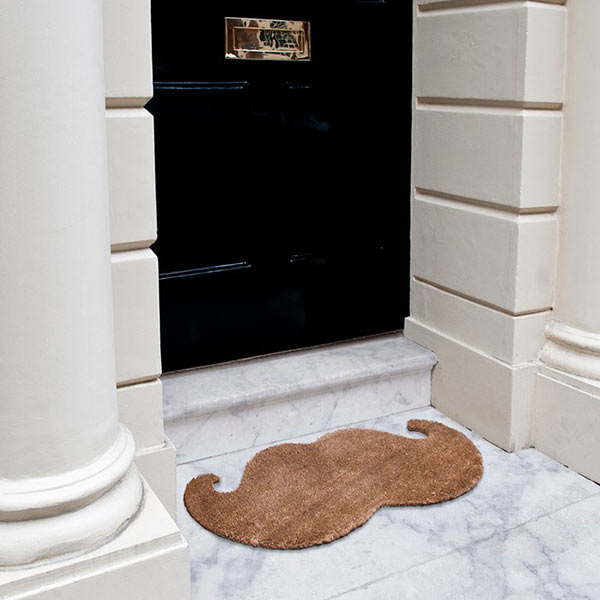 The Moustache Doormat comes in a cylinder gift box