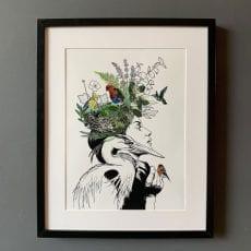Birds Nest Lady Framed Print